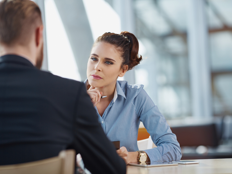Woman interviewing a man