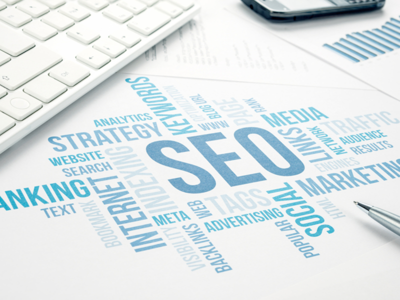A desk with graphics relating to SEO on it