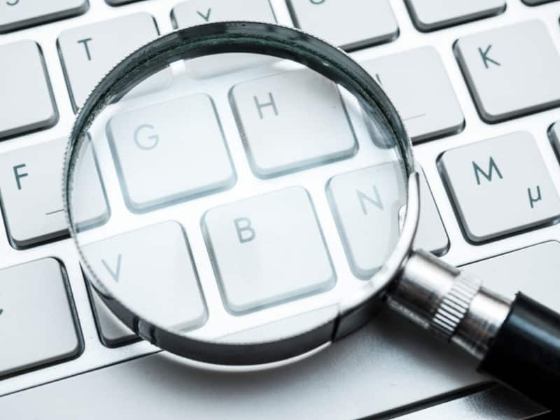 magnifying glasses on a laptop keyboard
