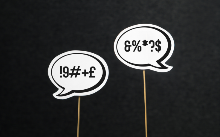 two bubble speech with unidentified symbols representing negative reviews