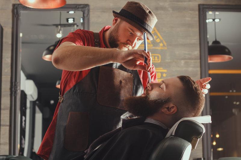 a barber doing his job