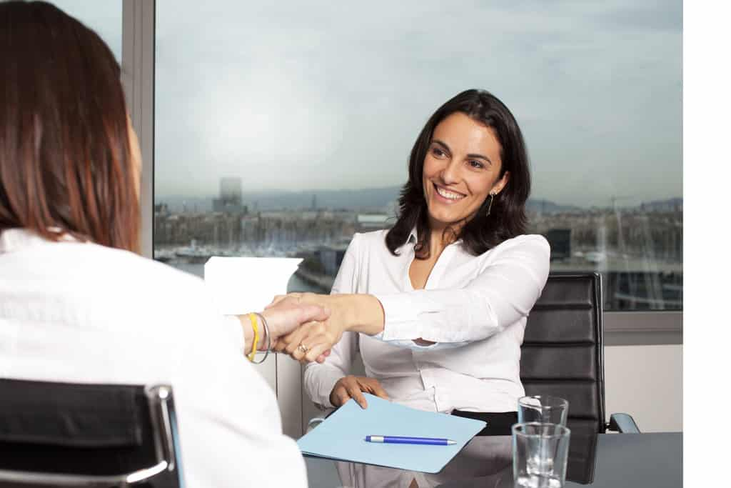 A small business owner agrees to a banking solution with banker