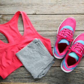 A Full Women's Running Outfit on a wooden floor