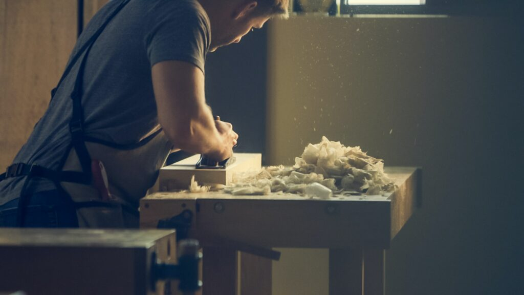 Woodworker Working At Table Byburst 1024x576