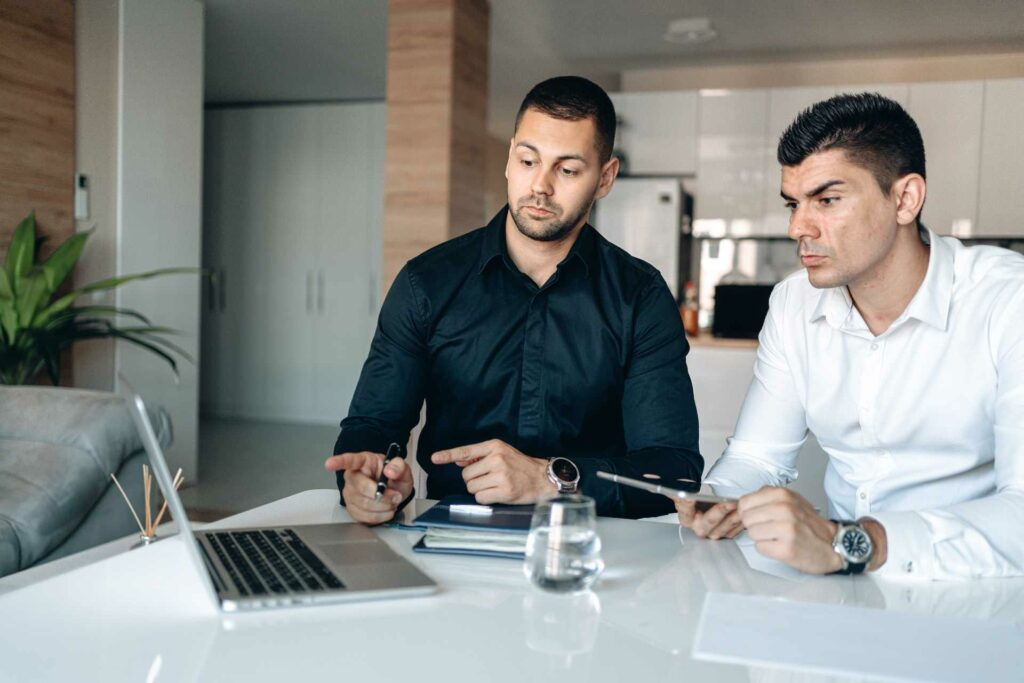Two businessmen checking out a business online and comparing it with another  Photo by George Morina from Pexels