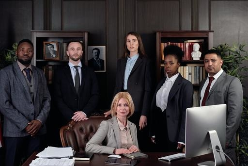 A group of legal professionals posing for a company shot
