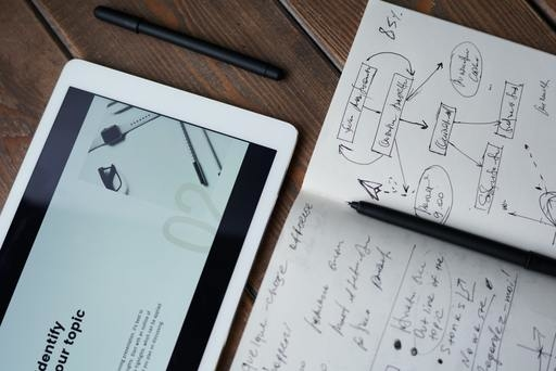 Notebook And Tablet With Marketing Strategy By Fauxels