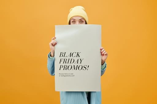 Woman holding a black friday poster with CTAs on it