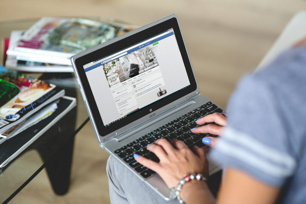 A Person Browsing Facebook on a Laptop