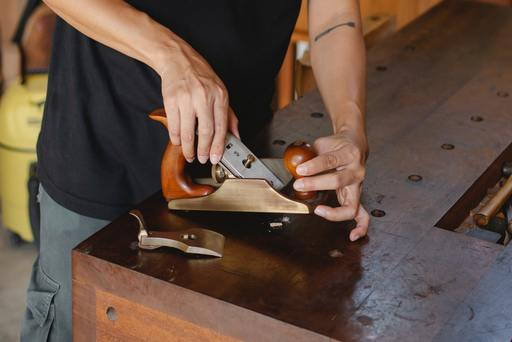 A craftsman using a knife for review