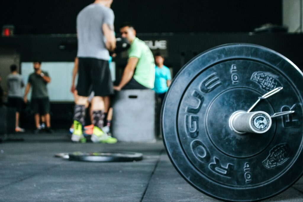 A closeup on a barbell in a personal training gym.