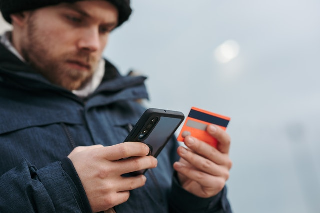 Man trying to buy something online from his smartphone
